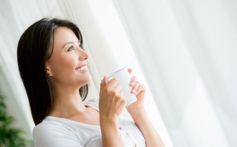 Content women with a drink
